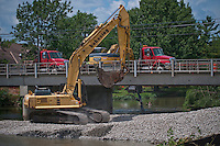 Temporary gravel roadway built beside Main Street Bridge during construction
