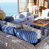 The living room has sea views and the chairs are upholstered in fabrics from India and Malabar