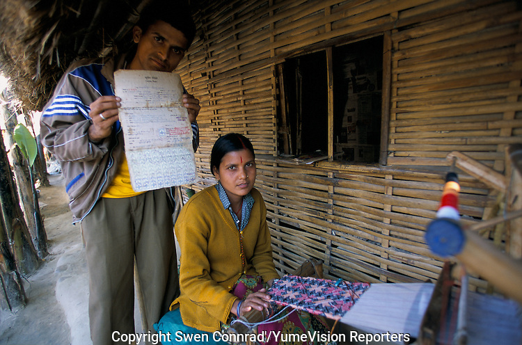 Under UNHCR protection, the life of 135000 Bhutan refugees in the 7 camp (near Damak, Nepal). A couple with a child are proving with tax received the legitimacy of there Bhutanese citizenship..-The full text reportage is available on request in Word format