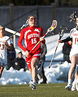 Boston University midfielder Ally Adams (15)..Boston College (white) defeated Boston University (red), 12-9, on the Newton Campus Lacrosse Field at Boston College, on March 20, 2013.
