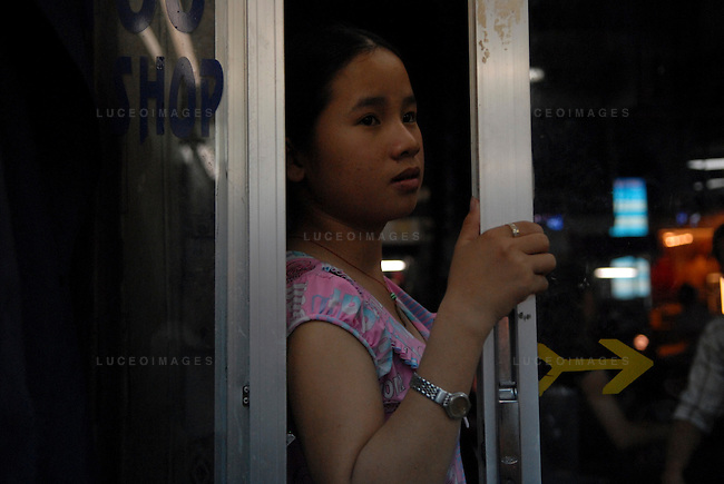 A Vietnamese girl at a barber shop in Ho Chi Minh City, Vietnam.