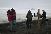 Couples at McMurdo Station in Antarctica enjoy the opening moments of New Years Day, 2001 as the icebreaker Polar Sea carves a channel into the harbor. many residents at McMurdo prefer to see the new year arrive outside, where it is daylight all the time. Ernie Mastroianni photo