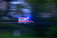 Dial 112 for Emergencies in Europe - an Ambulance speeds to a call along the Rhein river.