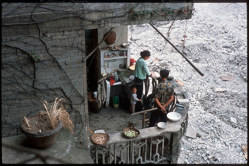 Fengdu, China, August 2003.A few very poor families still live in derelict buildings in the old city of Fengdu, already half-destroyed to allow the Three Gorges Dam project to be completed.