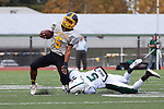 Mountain View High running back Marcus Jones gets dragged down by Palo Alto's Jay-shawn Gates-Mouton in a Nov. 2 game.<br />