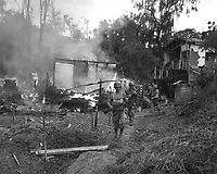 Leathernecks lead patrol between destroyed buildings in &quot;mop-up&quot; of Wolmi Island, gateway to Inchon.  September 15, 1950.  Sgt. Frank C. Kerr. (Marine Corps)<br /> NARA FILE #:  127-N-A2739<br /> WAR &amp; CONFLICT BOOK #:  1423