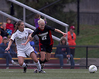 NC State midfielder/forward Stephanie Bronson (27) tripped up as Boston College forward Alaina Beyar (17) redirects the ball. Boston College defeated North Carolina State,1-0, on Newton Campus Field, on October 23, 2011.