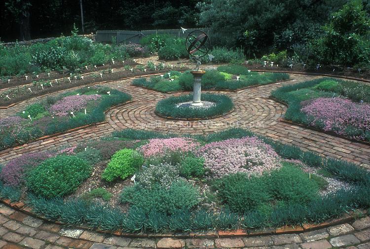 Herb garden formal circular sundial focal point Plant