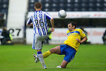 Kilmarnock v St Johnstone...01.10.11   SPL Week 10.Calum Davidson puts in a crunching challenge on Alex Pursehouse.Picture by Graeme Hart..Copyright Perthshire Picture Agency.Tel: 01738 623350  Mobile: 07990 594431