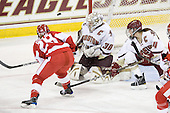 Marie-Philip Poulin (BU - 29), Molly Schaus (BC - 30), Katelyn Kurth (BC - 14) - The visiting Boston University Terriers defeated the Boston College Eagles 1-0 on Sunday, November 21, 2010, at Conte Forum in Chestnut Hill, Massachusetts.