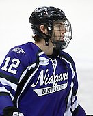 C.J. Chartrain (Niagara - 12) - The visiting Niagara University Purple Eagles defeated the Northeastern University Huskies 4-1 on Friday, November 5, 2010, at Matthews Arena in Boston, Massachusetts.