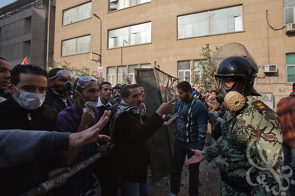 Egyptian soldiers try to calm protesters as they try to establish a buffer zone between them and riot police during clashes November 22, 2011 near Tahrir square in central Cairo, Egypt. Thousands of protestors demanding the military cede power to a civilian government authority clashed with Egyptian security forces for a fourth straight day in Cairo, with hundreds injured and at least 29 protestors killed so far.  (Photo by Scott Nelson)