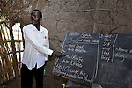 Michael Lam teaches in a classroom in Detang, a small village across the Upper Nile River from Malakal, in Southern Sudan. Teachers in this school, including Lam, are participating in a training program run by Solidarity with Southern Sudan, an international network of Catholic groups supporting Southern Sudan with educational personnel and prayer.