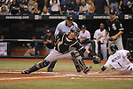 ST. PETERSBURG - OCTOBER 2:  A.J. Pierzynski #12 of the Chicago White Sox attempts to tag Akinori Iwamura #1 in the 3rd inning of the game against the Tampa Bay Rays at Tropicana Field in St. Petersburg, FL on October 2, 2008.  Iwamura was safe on the play.  The Rays defeated the White Sox 6-4.  (Photo by Ron Vesely)