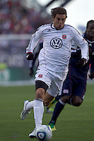 DC United defender Dejan Jakovic (5) on the attack. In a Major League Soccer (MLS) match, the New England Revolution defeated DC United, 2-1, at Gillette Stadium on March 26, 2011.