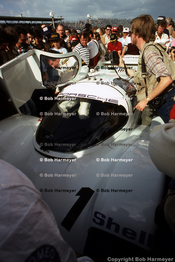 DAYTONA BEACH, FL - FEBRUARY 4: Mario Andretti climbs into the Porsche 962 001 before the start of the 24 Hours of Daytona on February 4, 1984, at the Daytona International Speedway in Daytona Beach, Florida.