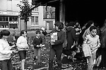 Toxteth Liverpool after riots. July 1981. Local children help them selves to good from a shop that had been looted during the previous nights riots.
