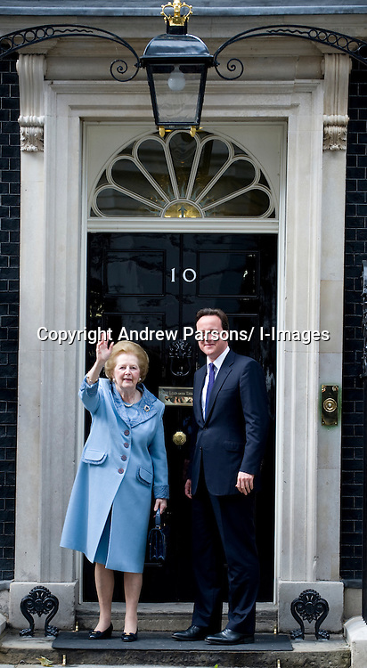 British Prime Minister David Cameron greets former Prime Minister Baroness Thatcher on the steps of Number 10 Downing Street, , Tuesday June 8, 2010.  Photo By Andrew Parsons/i-Images