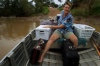 Residents try to keep cars on the other side, but need time to cross the river by boat before it's too high or too low to cross.  <br /> Cowboys wait for the water to get low enough to take their trucks across.