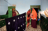Suweys, the captain of the Somali women&acute;s basketball team, at home while making ready to go for afternoon training saying goodbye to her mother ...Death or Play. Women&acute;s Basketball in Mogadishu.Women's basketball? In Europa and the U.S., we take it for granted. But consider this: In Mogadishu, war-torn capital of Somalia, young women risk their lives every time they show up to play..Suweys, the captain of the Somali women&acute;s basketball team, and her friends play the sport of the deadly enemy, called America. This is why they are on the hit list of the killer commandos of Al Shabaab, a militant islamist group, that has recently formed an alliance with the terrorist group Al Qaeda and control large swathes of Somalia...Al Shabaab, who sets bombs under market stands, blows up cinemas, and stones women, has declared the female basketball players ?un-islamic?. One of the proposed punishments is to saw off their right hands and left feet. Or simply: shoot them...Suweys&acute; team trains behind bullet-ridden walls, in the ruins of the failed city of Mogadishu - protected by heavily armed gun-men. The women live in constant fear of the islamist killer commandos. Stop playing basketball? Never, they say..Women&acute;s basketball in the world&acute;s most dangerous capital..