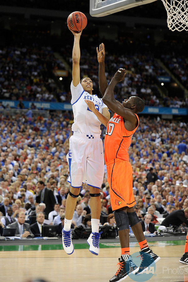 31 MAR 2012: Forward Anthony Davis (23) of the University of Kentucky puts up a shot in front of center Gorgui Dieng (10) of the University of Louisville during the Semifinal Game of the 2012 NCAA Men's Division I Basketball Championship Final Four held at the Mercedes-Benz Superdome hosted by Tulane University in New Orleans, LA. Ryan McKeee/ NCAA Photos.