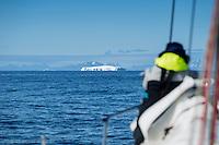 Sailing towards large iceberg off east coast of Greenland