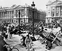 Crowds of Parisians celebrating the entry of Allied troops into Paris scatter for cover as a sniper fires from a building on the place De La Concorde.  Although the Germans surrendered the city, small bands of snipers still remained.  August 26, 1944.  Verna. (Army)<br /> NARA FILE #:  111-SC-193008<br /> WAR &amp; CONFLICT BOOK #:  1057