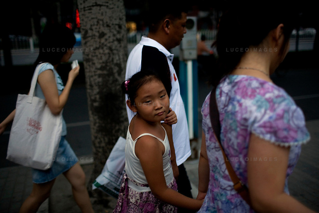 A Beijing family walks to a restaurant for dinner in China on Thursday, August 7, 2008. The city of Beijing is gearing up for the opening ceremonies of the Olympic Games.  Kevin German