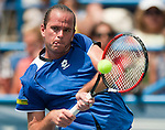 Aug 7, 2010 - Washington, District of Columbia, U.S., - XAVIER MALISSE returns a volley against Marcos Baghdatis in the Legg Mason Tennis Classic semifinals in Washington on Saturday. The Eighth-seeded Baghdatis defeated the unseeded MALISSE 6-2, 7-6 (4) .(Credit Image: © Pete Marovich/ZUMA Press)