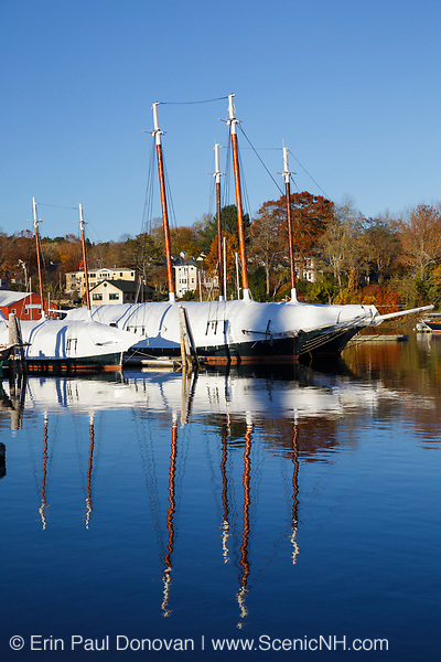 Reflection of boats in Camden Harbor in downtown Camden, Maine during the autumn months.
