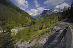 Road through the Hahntennjoch pass, showing evergreen forests streams and mountains. Imst district, Tyrol, Tirol, Austria.
