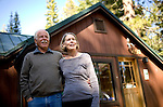 Ron, left, and Sally Grassi pose for a portrait outside their Tahoe City, Calif. home May 13, 2010. Grassi is suing the big three ratings agencies after he lost $40,000 on a Lehman Brothers bond.