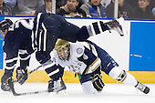 Blake Kessel (UNH - 20), Riley Sheahan (Notre Dame - 4) - The University of Notre Dame Fighting Irish defeated the University of New Hampshire Wildcats 2-1 in the NCAA Northeast Regional Final on Sunday, March 27, 2011, at Verizon Wireless Arena in Manchester, New Hampshire.