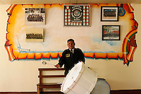 Julio Coaquira Tiutaya plays a drum with the band at the Tiquina Bolivian Navy Base on Lake Titicaca. Bolivia lost what is now northern Chile in a war over nitrates leaving Bolivia without access to the ocean.