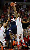 Ohio State Buckeyes guard Amedeo Della Valle (33) and Ohio State Buckeyes center Amir Williams (23) defend Illinois Fighting Illini guard Rayvonte Rice (24) in the first half at Value City Arena in Columbus Jan. 23, 2013 (Dispatch photo by Eric Albrecht)