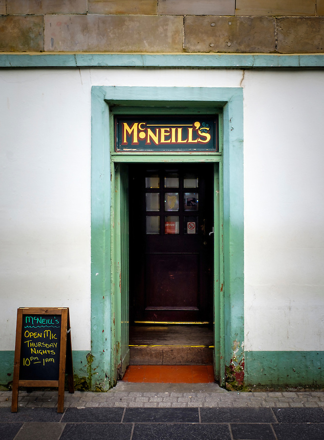LEWIS AND HARRIS, SCOTLAND - CIRCA APRIL 2016: Entrance door of typical pub in Stornoway one of the major towns of outer islands of Lewis and Harris in Scotland..