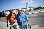 Developers, and brothers, Tim, left and Bernie Carter walk through Reno, Nevada's Midtown district, July 6, 2012. Bernie Carter is also running for a seat on Reno's city council.
