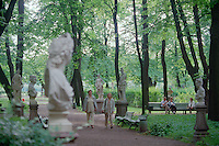 Saint Petersburg, Russia, June 2002..Petersburgers make the most of the city's famous parks and waterways at any time of the year - statues and passers-by in the city centre Summer Garden..