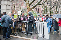Street food vendors pass security in front of New York City Hall prior to entering the City Council on Wednesday, February 27, 2013. The City Council is voting today to lower the draconian $1000 fines (to $500) imposed by the city for various minor administrative infractions unrelated to health and sanitation. The vendors credit NY City Council Speaker for bringing the bill to lower the fines to the floor and for the majority of votes needed to override Mayor Michael Bloomberg's announced veto. (© Richard B. Levine)
