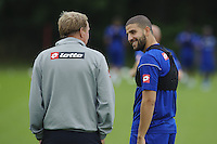 QPR manager Harry Redknapp and greets Adel Taarabt