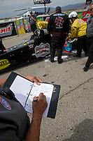 Mar 29, 2014; Las Vegas, NV, USA; Detailed view as an NHRA official fills out an oil down report after top fuel driver Scott Palmer oiled the track during qualifying for the Summitracing.com Nationals at The Strip at Las Vegas Motor Speedway. Mandatory Credit: Mark J. Rebilas-USA TODAY Sports