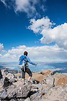 Female hiker takes in view over Mono basin from summit of Mt. Dana (13,053 ft), Yosemite national park, California, USA