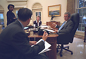 United States President George W. Bush works on his address to the nation regarding the September 11, 2001 attacks with Speechwriter Mike Gerson, Nation Security Advisor Dr. Condoleezza Rice, and Counselor Karen Hughes in the Oval Office of the White House in Washington, D.C. on Thursday, September 20, 2001..Mandatory Credit: Eric Draper - White House via CNP.