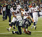 Seattle Seahawks running back Thomas Rawls tumbles into the end zone against the Denver Broncos during the fourth quarter at CenturyLink Field on August 14, 2015 in Seattle Washington.  Rawls run for a touchdown on a 19-yard pass from quarterback A.J. Archer. The Broncos beat the Seahawks 22-20.  © 2015. Jim Bryant Photo. All Rights Reserved.
