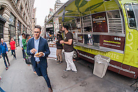Olive Garden fans and the curious line up at the Olive Garden truck in the Flatiron District in New York to sample the casual dining restaurant's new offering, the Breadstick Bun Sandwich, on Thursday, June 4, 2015. Olive Garden has been making changes to its menu in an effort to reverse the slump that is effecting casual dining restaurants. Recently, the board members of the company worked greeting and serving guests to gain hands-on experience. (© Richard B. Levine)