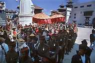 February 24th, 1975. Kathmandu. Nepal. The Coronation of King Birendra and Queen Aishwarya of Nepal, on the chosen day. At 8:37 a.m., the precise moment selected by court astrologers more than a year before, the royal priest placed the huge jewel-encrusted crown on the King's head and a diamond tiara atop Queen Aishwarya's. They were both massacred by their son Dipendra  on 1 June 2001. The King and the Queen taking place to the Royal parade.