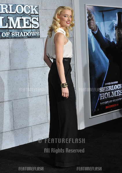 """Amber Heard at the Los Angeles premiere of """"Sherlock Holmes: A Game of Shadows"""" at the Village Theatre, Westwood..December 6, 2011  Los Angeles, CA.Picture: Paul Smith / Featureflash"""
