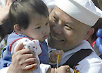 Petty Officer 2nd class Ronnie Akhaphont hugs his four-month-old daughter , Kelley, who was born while he was at sea. The USS Abraham Lincoln returned from a nine and a half-month-long deployment on Tuesday, May 6, 2003 at Everett, WA. Jim Bryant Photo
