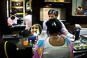 A customer tries on gold jewelry at a Mehrasons Jewellers store in New Delhi, India. Photo: Sanjit Das/Panos Pictures