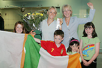 2/8/2010. Derval O'Rourke arrives back into Dublin Aiorport pictrured Minister for Tourism Culture and Sport Mary Hanafin with fans Grainne 5 and Sarah 9 Hanley from Skryne Co Meath and Mathew 9 and Jessica 7 Brennan from Rathog Co Meath. European silver-medallist Derval O'Rourke has arrived home from Barcelona.O'Rourke finished second in the 100m hurdles on Saturday night to win her second European Athletics Championship silver medal. She was presented with her medal at the Olympic Stadium in Barcelona yesterday evening. Picture James Horan/Collins Photos.